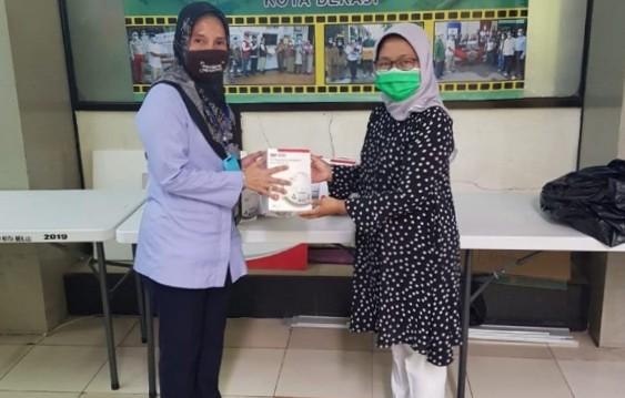 Foto Caption: PDAM Salurkan Paket Sembako dan Zakat Fitrah Melalui Baznas, Selasa, (19/5).